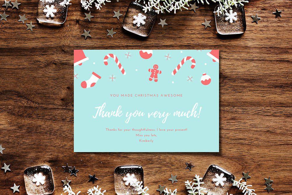 christmas-greeting-card-mockup-generator-on-wood-desk