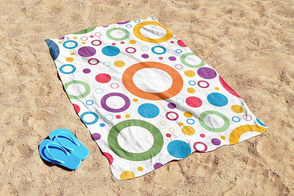 free-beach-towel-on-beach-sand-realistic-towel-online-mockup-generator-psd-template-2-