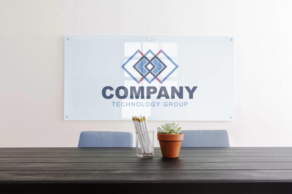 company-glass-sign-logo-over-business-desk-board-room-meeting-desk