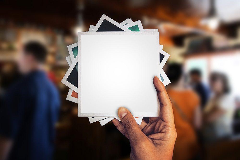 03-holding-polaroid-photo-psd-template