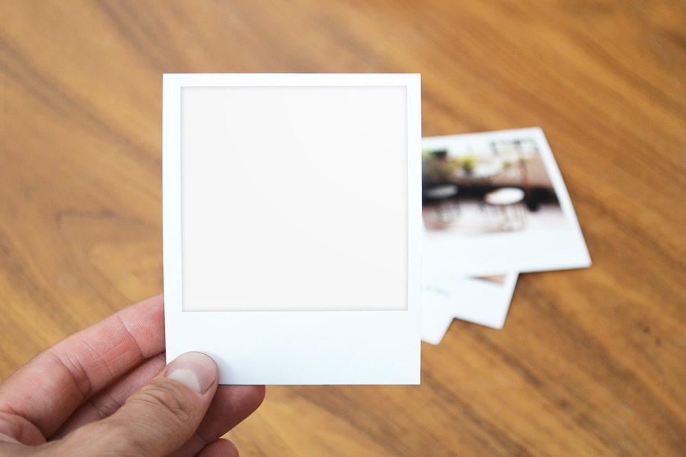 06-holding-polaroid-photo-psd-mockup