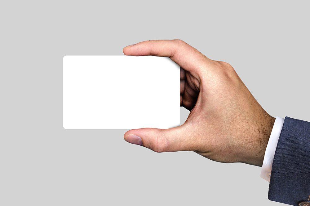 07-man-holding-credit-card-mockup