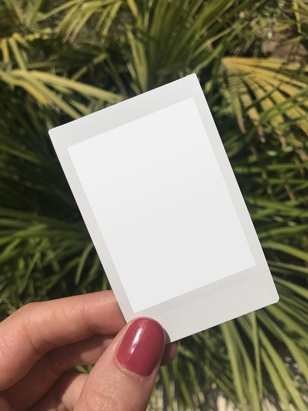 12-hand-holding-polaroid-frame-mockup