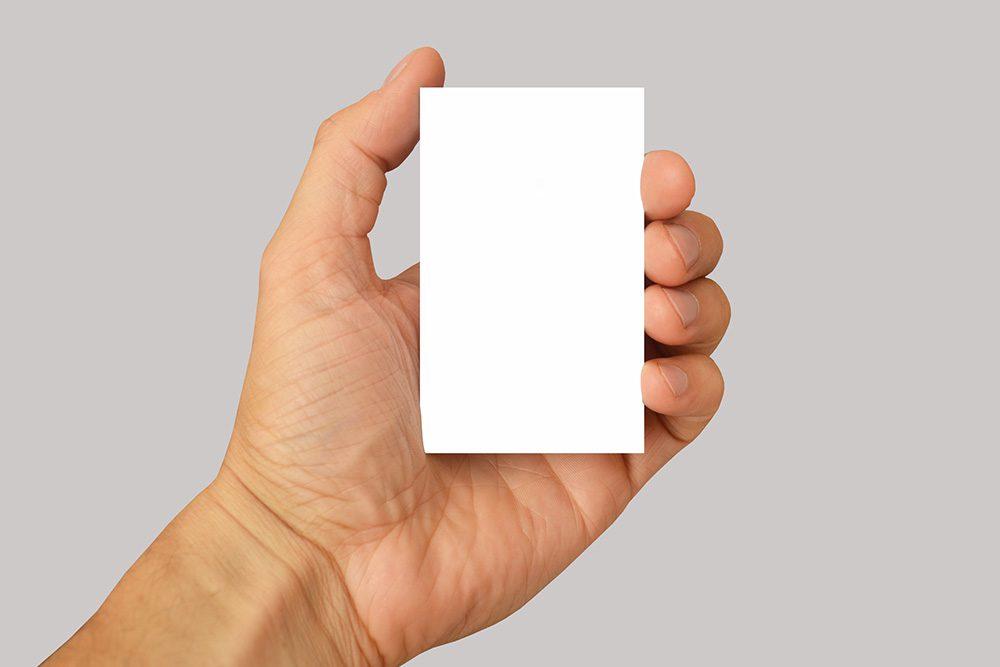 14-man-holding-vertical-business-card-transparent-PNG-mockup