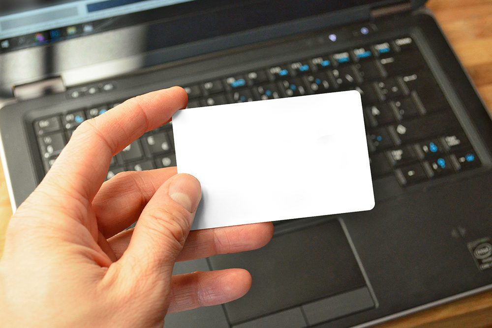 16-man-holding-credit-card-laptop-online-payment