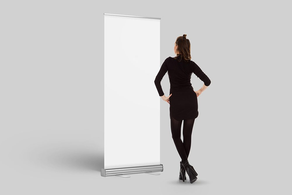 17-exhibition-woman-looking-at-banner