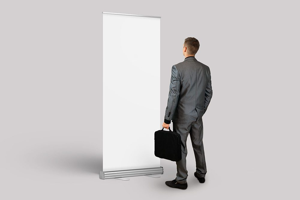 18-exhibition-booth-rollup-mockup-with-business-man