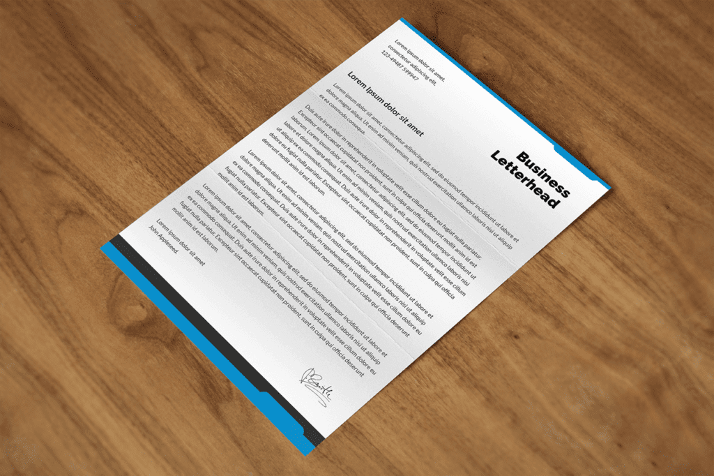 18-psd-mockup-template-featuring-a4-paper-on-wood-desk