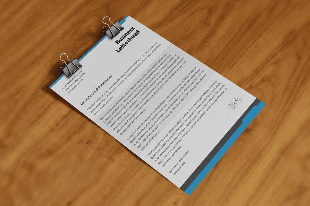 21-business-branding-letterhead-mockup-on-wood-desk