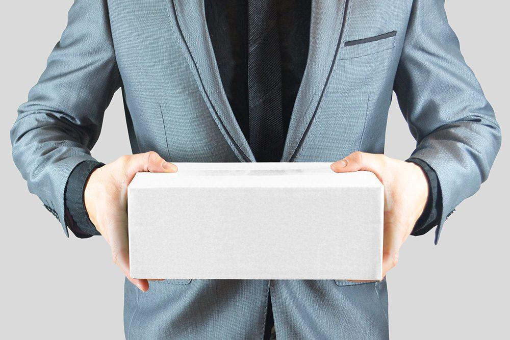 21-man-holding-box-mockup-psd