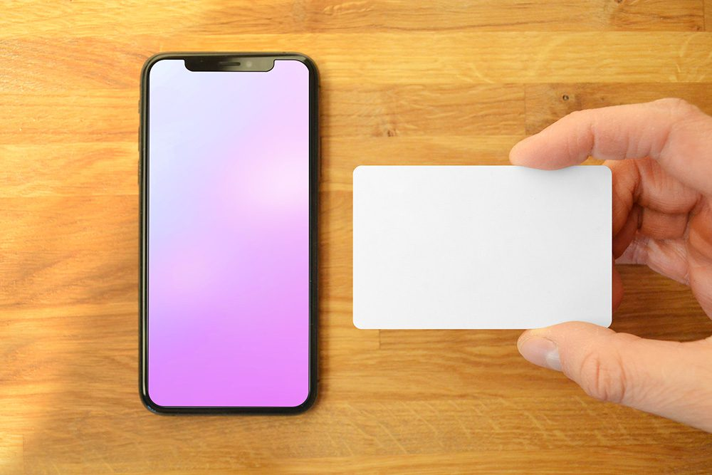 23-iphone-and-hand-holding-credit-card