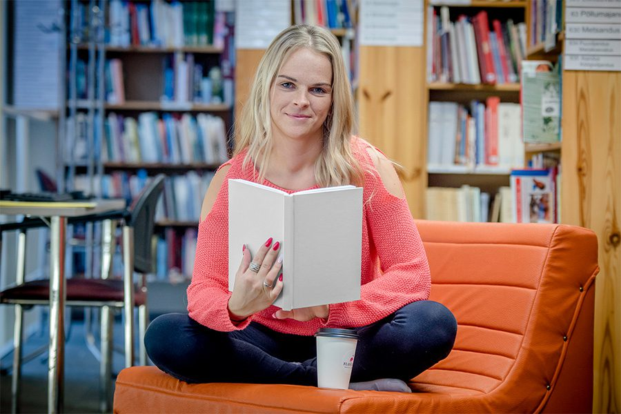 woman holding book mockup