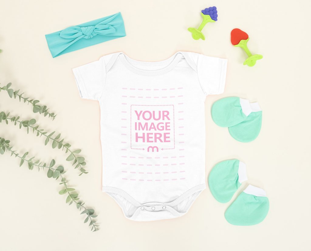 Customizable Baby Bodysuit Mockup Laid Over a Light Brown Background