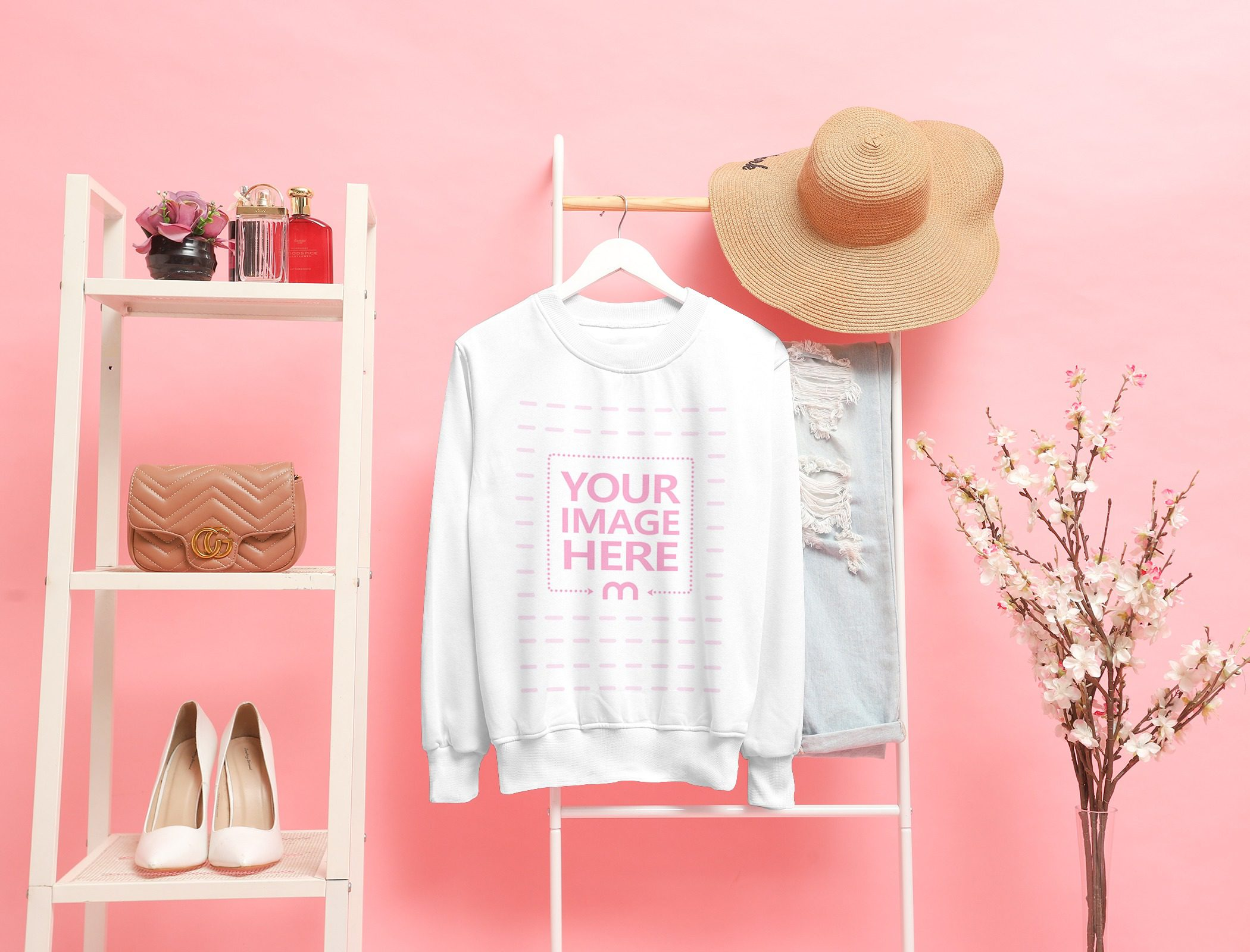 Customizable Mockup of a Crewneck Sweatshirt Hanged on a Stair With Pink Background