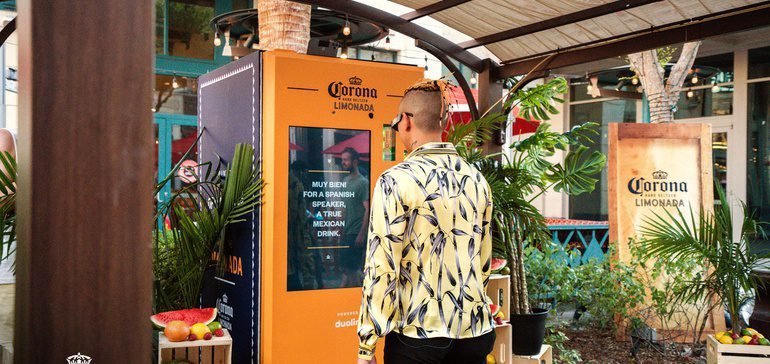 Man using the Duolingo & Corona voice-activated vending machine to get a free Hard Seltzer Limonada.